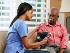 nurse home visits measures blood sugar to senior man