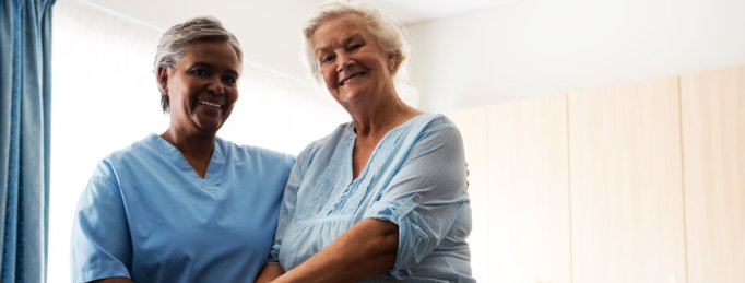 nurse and senior woman smiling