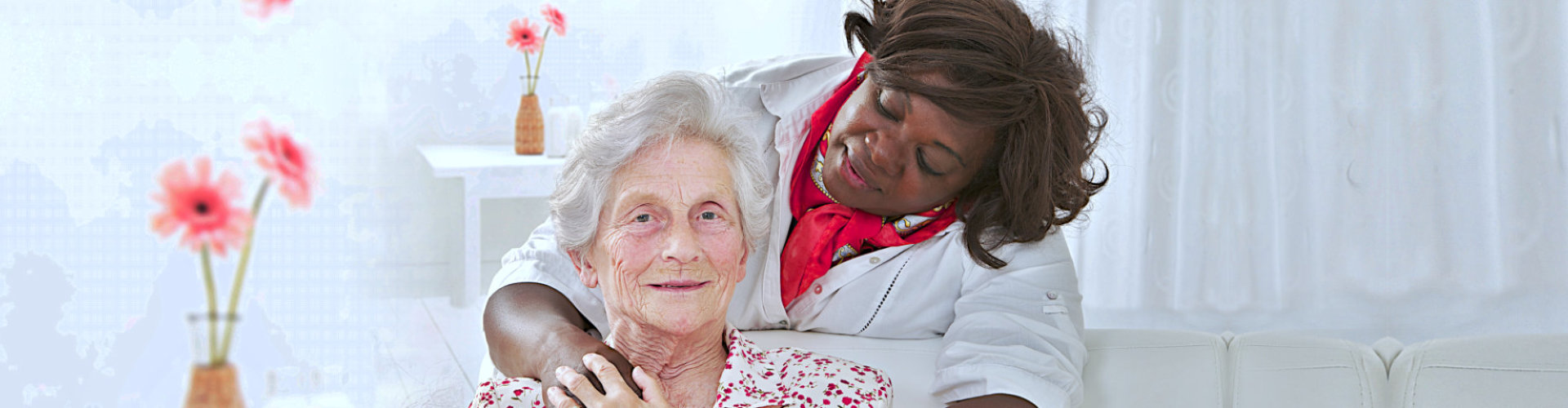 nurse hug senior woman smiling
